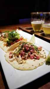 A flight of tacos and beer from San Juan del Sur Cerveceria. The grilled fish were the best
