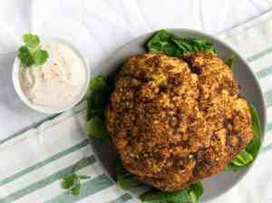 Roasted Harissa Cauliflower with Whipped Tahini makes a great side dish, dinner, and topping for salad bowls.