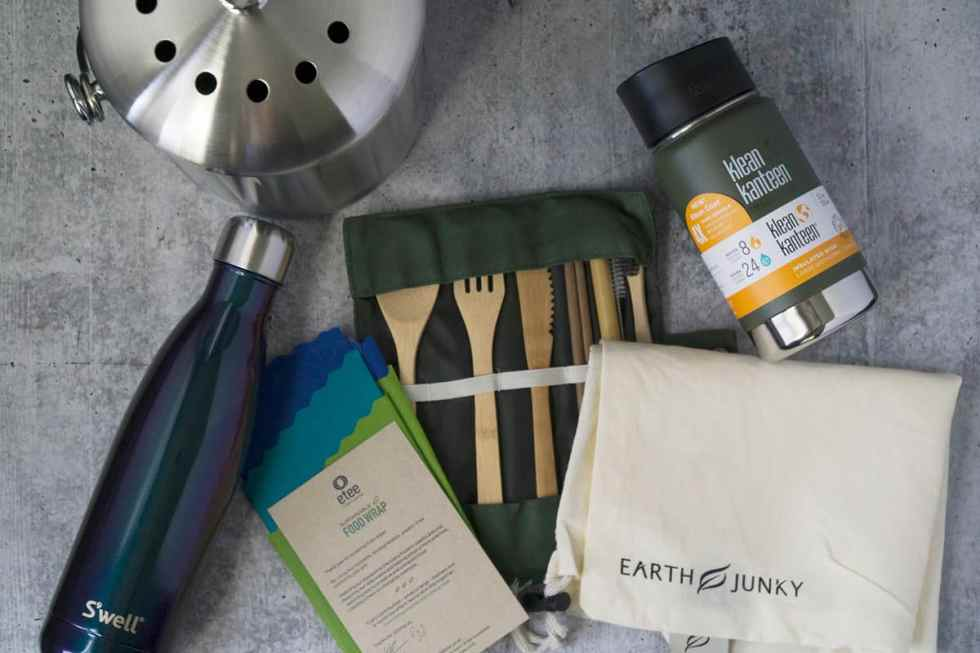 Eat Your Way Clean Earth Day GREEN GIVEAWAY featuring a compost bin, a Swell Water Bottle, Etee bees wax food wraps, Bamboo travel utensils, Klean Kanteen travel mug and Earth Junky produce shopping bag.