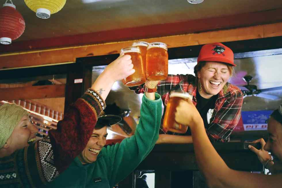People cheersing with beers to celebrate a game winning basket