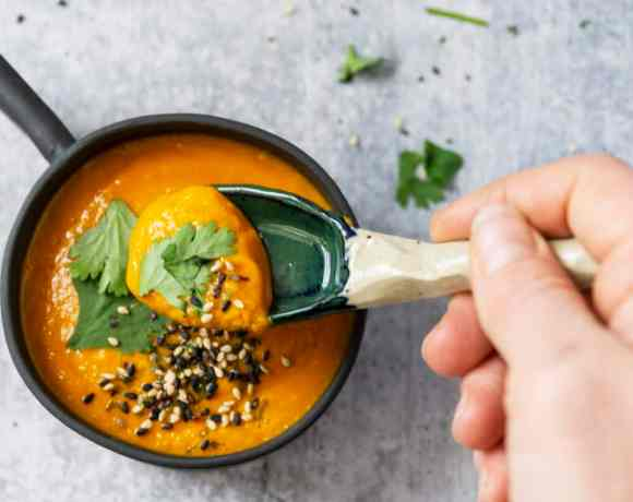Spoonful of Pumpkin Thai Curry Soup garnished with cilantro