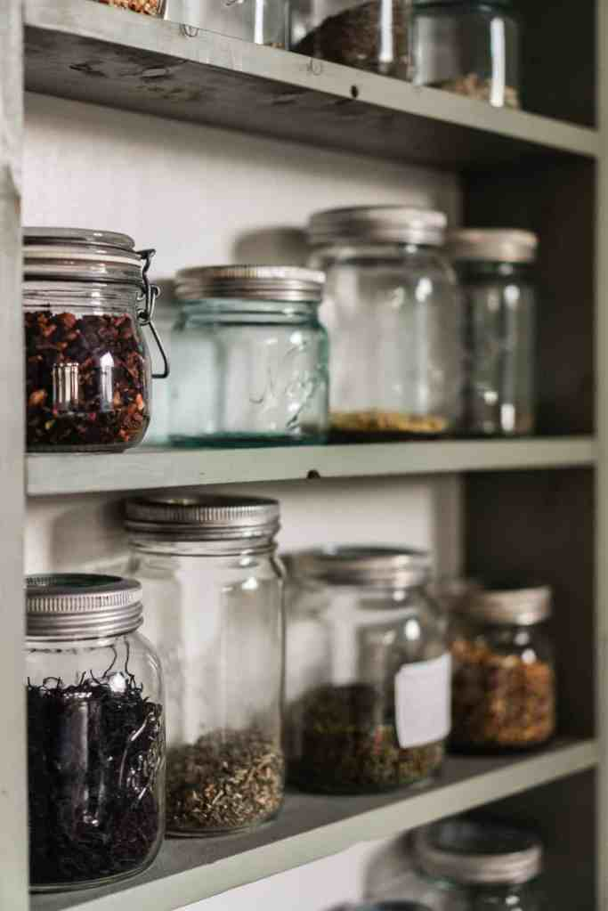 A clean pantry full of bulk items in mason jars