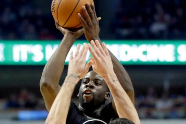 """""""Golden State Warriors forward Draymond Green (23) shoots over Chicago Bulls guard Kirk Hinrich (12) during the first half of an NBA basketball game in Chicago on Saturday, Dec. 6, 2014. (AP Photo/Nam Y. Huh)"""""""