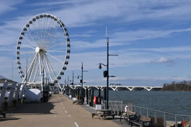 The wheel at National Harbor seen from the promenade. The Woodrow Wilson Memorial Bridge is in the background.