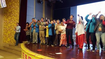 "The audience enthusiastically joined us in singing of ""Peng You,"" a Mandarin song about friendship."