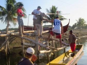The makeshift bamboo wharf at Tortugas