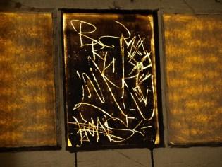 reverse graffiti on a window in The Rocks