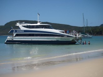 getting off the ferry at Whitehaven Beach involved getting wet to the hips