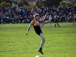 muso Tim Rogers makes a fine kick for the Rockdogs