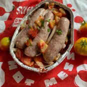 Sausages nestled in onions, garlic and tomatoes