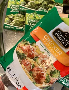 Frozen meatballs and packages of spinach