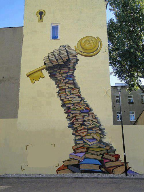 Mural depicting books as the key to knowledge