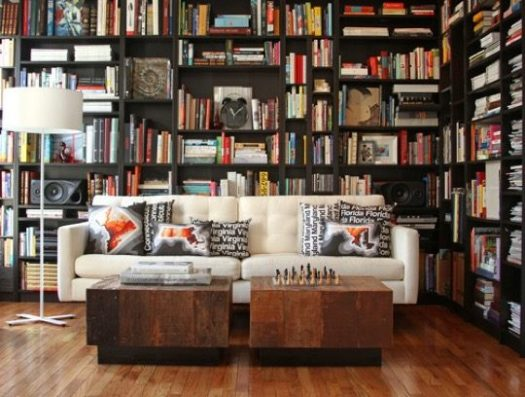 Contemporary Home Library With Irregular Bookshelves