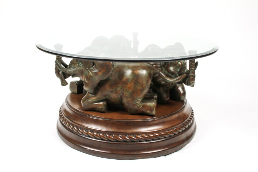 elephant base coffee table with glass top