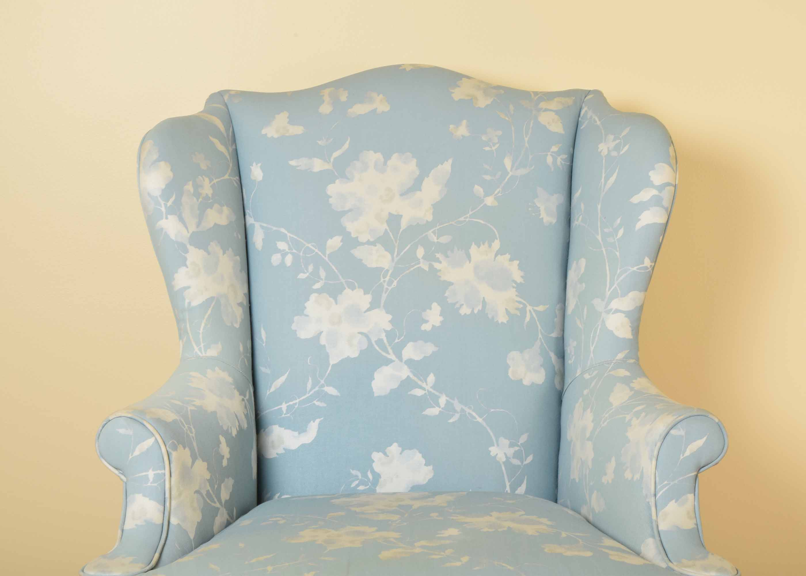 blue and white upholstered chairs folding circle chair target key city queen anne style wing