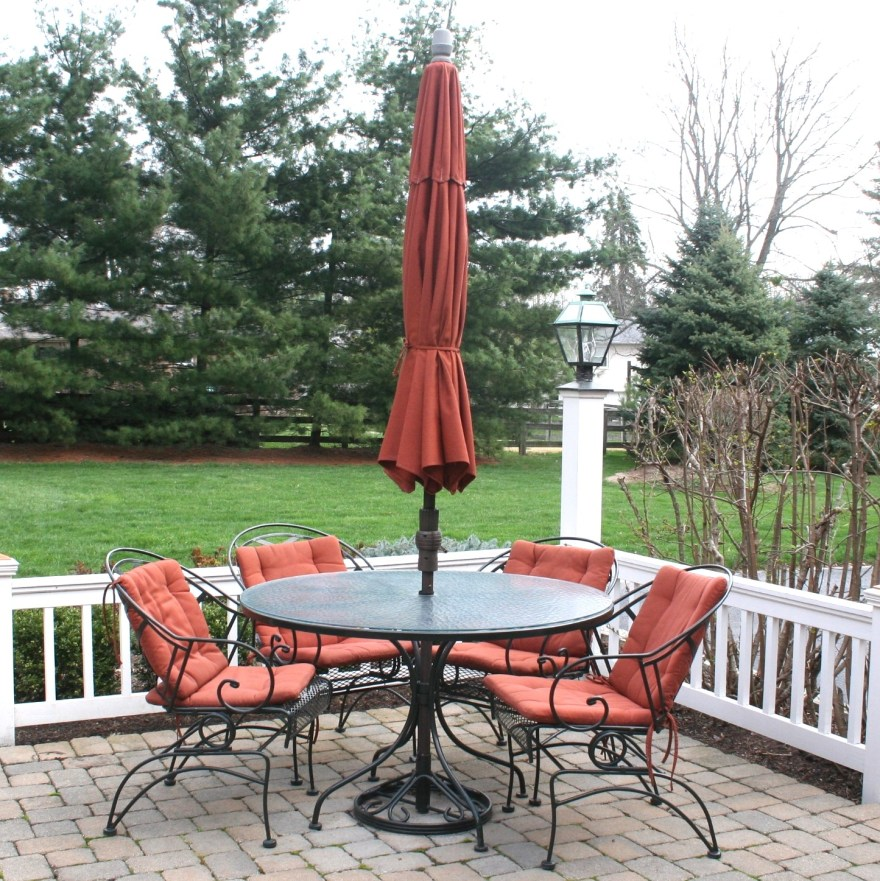 Frontgate Wrought Iron Patio Table And Four Chairs Ebth