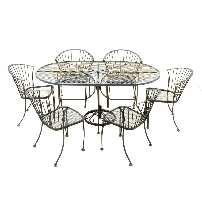 carolina forge patio table and six chairs