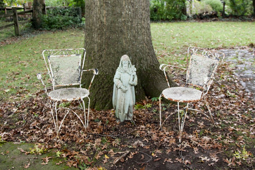 St. Fiacre Concrete Statue And Metal Garden Chairs Ebth