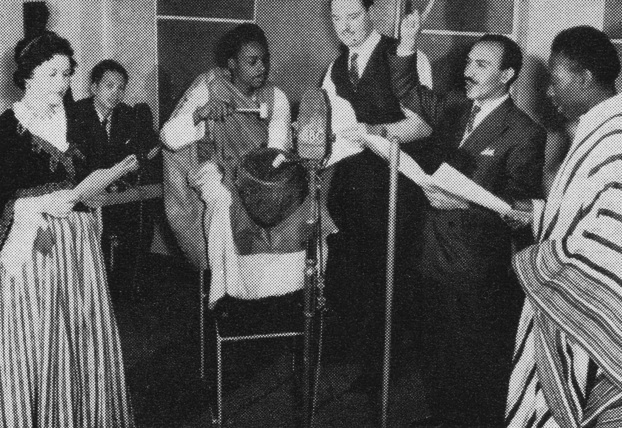 Musicians around a microphone