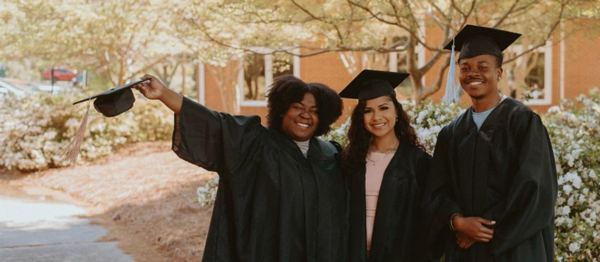 3 Graduates in the Quad