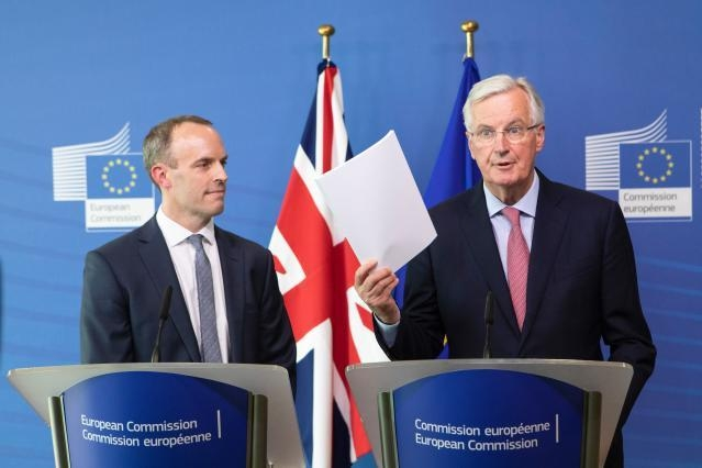 Dominic Raab, on the left, and Michel Barnier at the podium