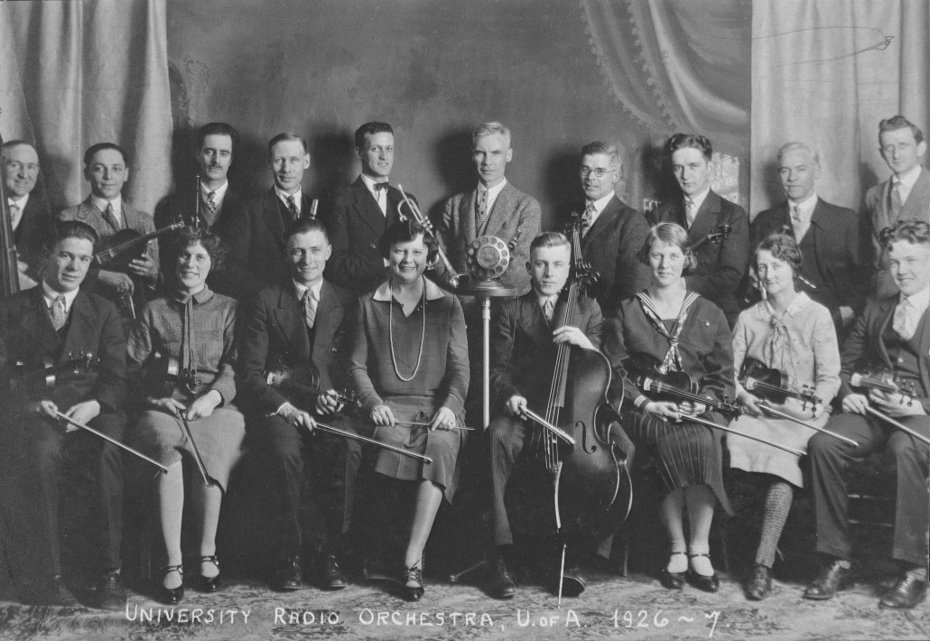 Beatrice Carmichael, front row, 4th from left. University of Alberta University Radio Orchestra, 1926-1927. Image courtesy of Provincial Archives of Alberta A3535.