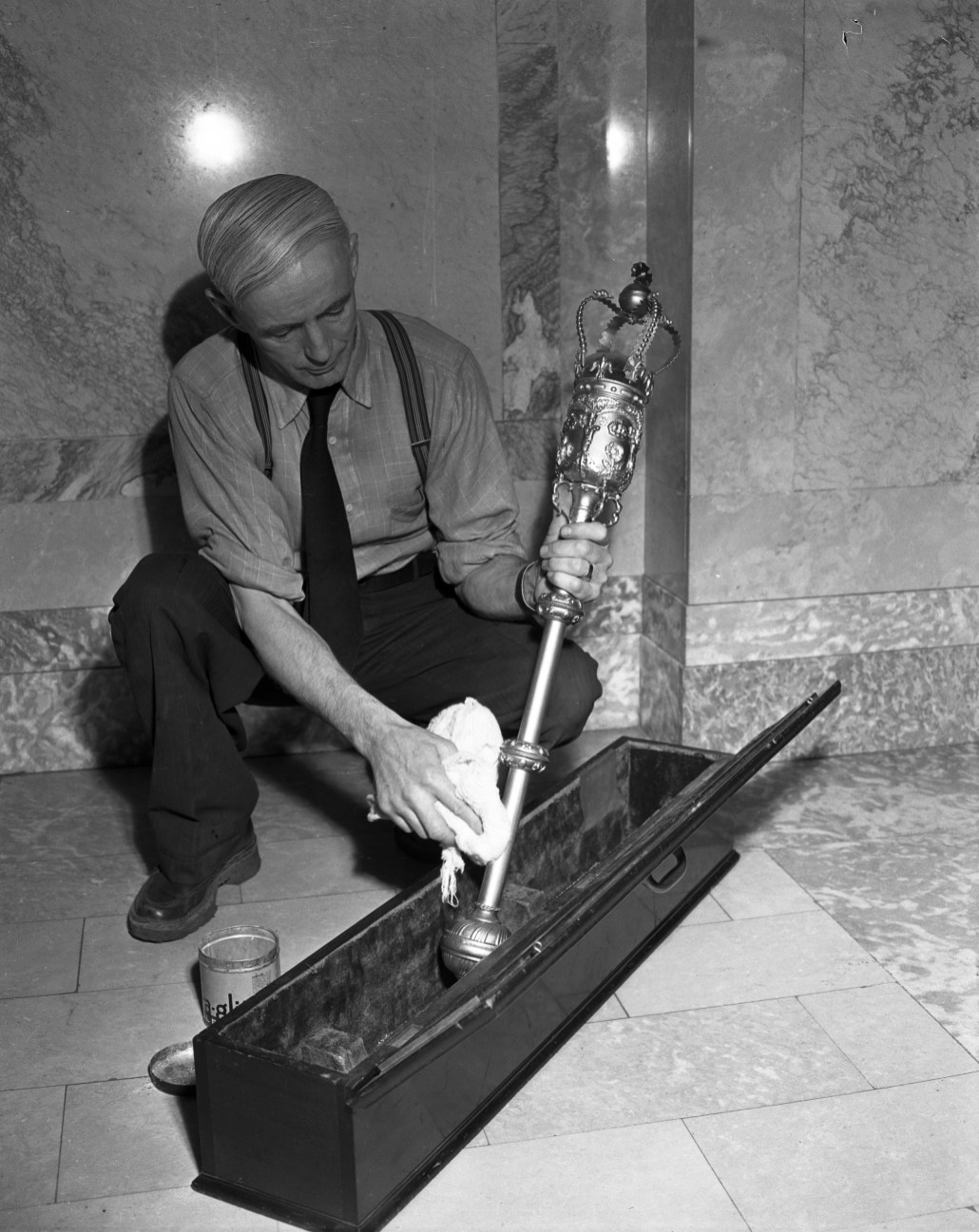 Preparing for Legislative Assembly opening. Alex McPhee shines the mace on February 21, 1950. Photo courtesy of the City of Edmonton Archives EA-600-3898a.