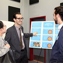 Gideon Litherland, Ph.D. in Counseling student, presents his research at the 100-year anniversary event.
