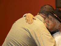 Orman hugs a Native elder whom he met at the Oregon State University Native American Longhouse Eena Haws.