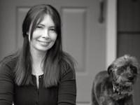 Oregon State University Ecampus psychology student Tracey Campion sits next to her dog, Poppy.