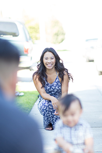 Samantha Diaz, OSU Ecampus graduate, plays with her youngest child outside her California home.