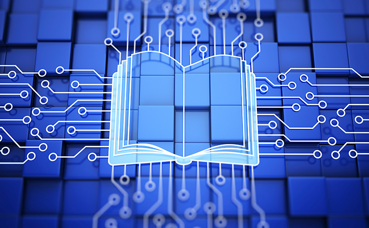 A digital rendering of an open textbook that looks like a computer chip