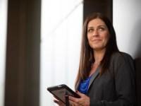 Oregon State University Ecampus business administration graduate Lisa Frasieur works on a tablet