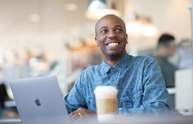 Oregon State Ecampus computer science student Myles Chatman sits in a coffee shop in the San Francisco Bay Area.
