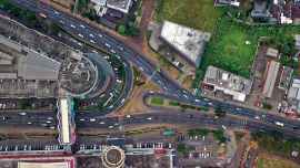 Aerial view of a crossroad. This post explores dome of the crossroads an unemployed or underemployed person may face.