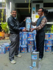 ECCA field staff Mr. Ram Sharan (right) hands over 29 filter sets to teacher and representative of KaliDevi H.S.S., Malta