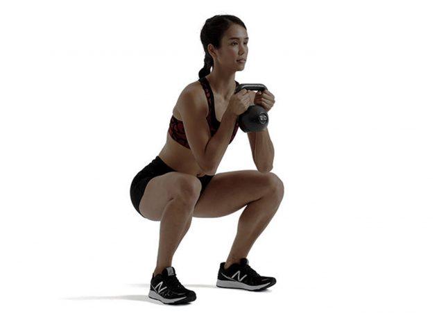 Squat classico con pesi