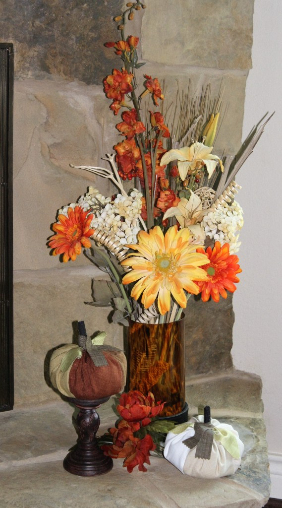 next to fireplace fall decor with handmade quilted fabric pumpkins