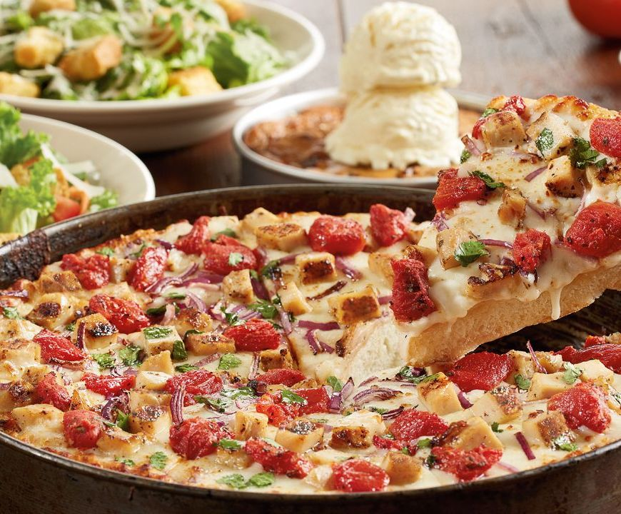 Deep dish pizza with side salads and a pizookie cookie dessert