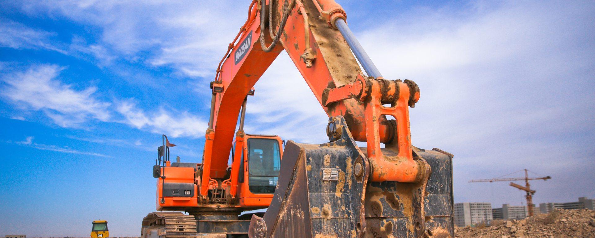 Orange Excavator in the beach
