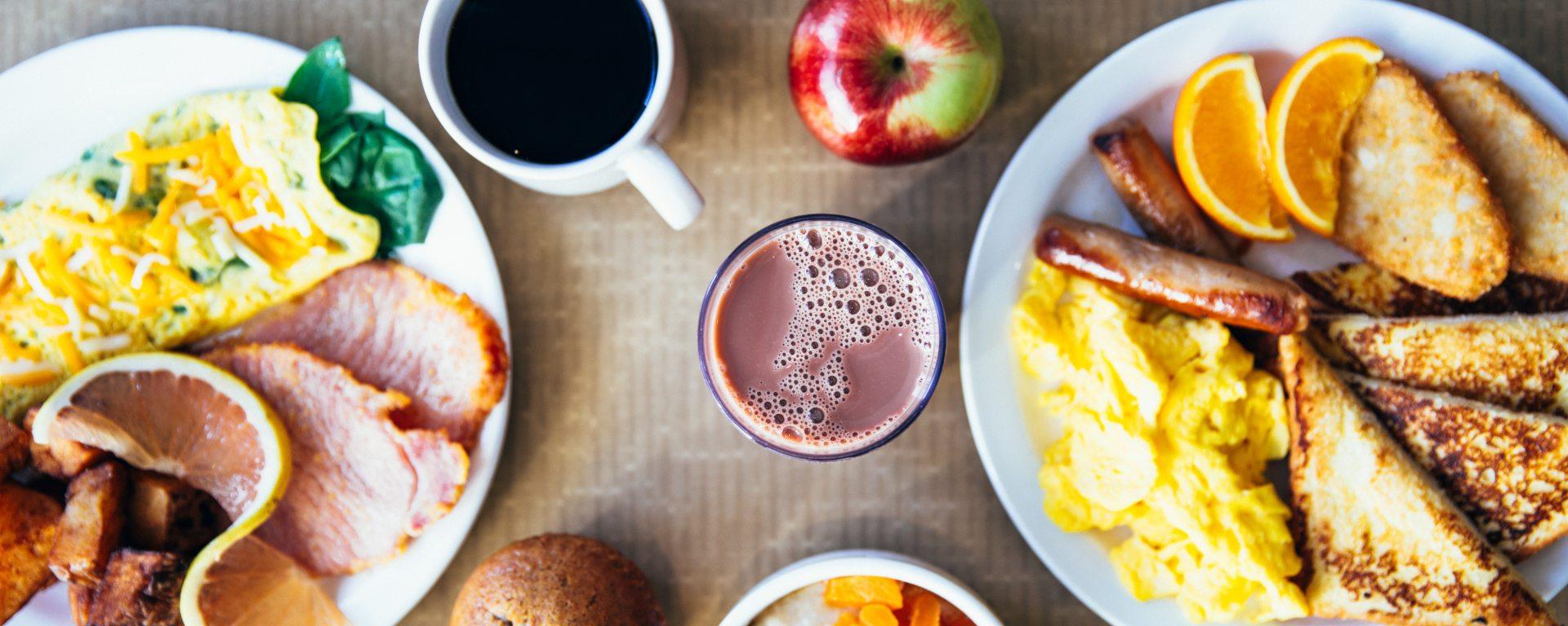 table full of breakfast foods