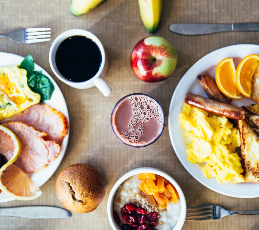table full of breakfast foods