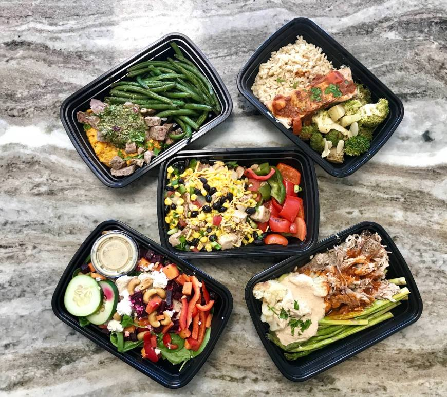 array of healthy meal choices in trays