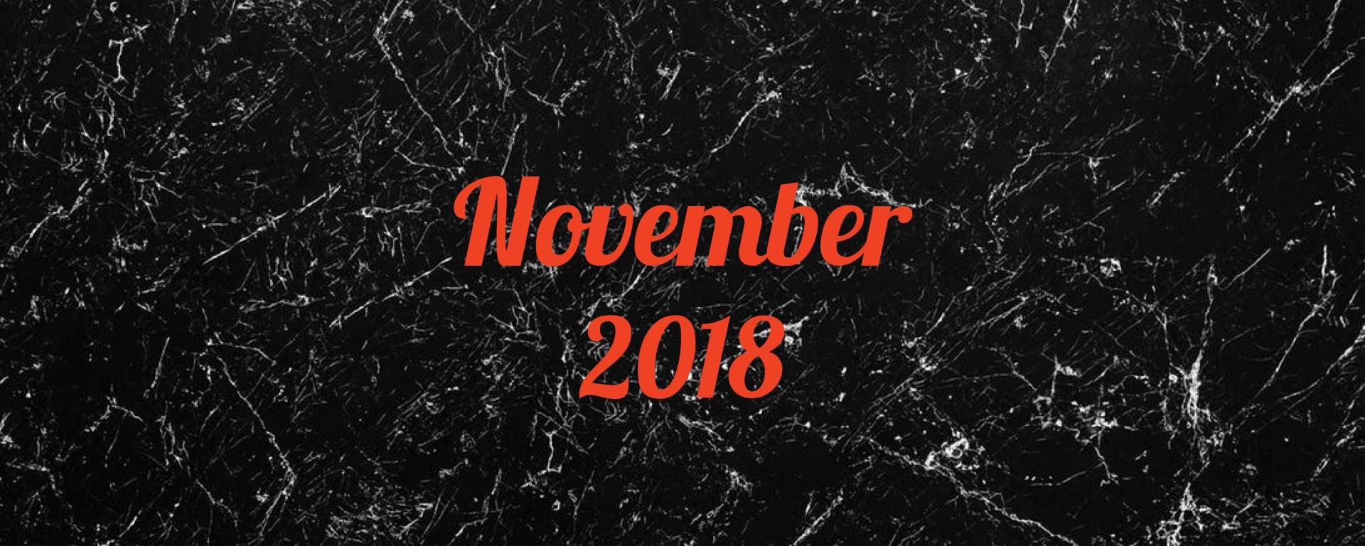 November 2018 in orange text on black and white marble background