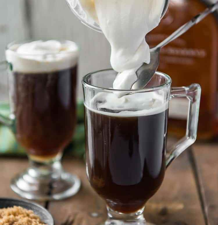 classic Irish coffee with cream in glass mug