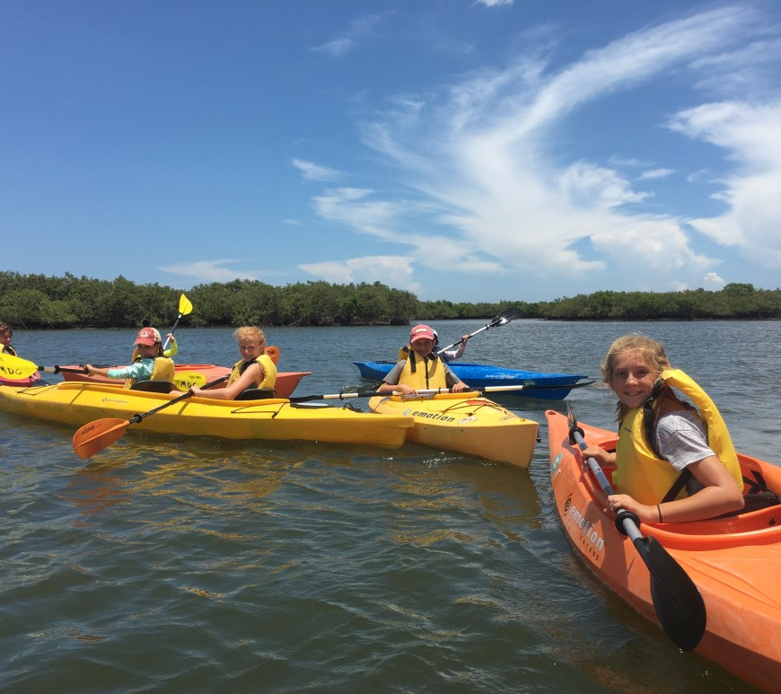 children kayaking in river