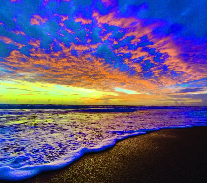 blue and orange sunset over beach