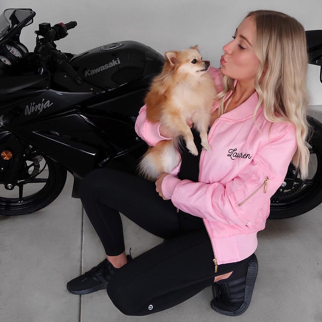 Lauren Curtis with her pet Mia and Kawasaki Ninja Bike