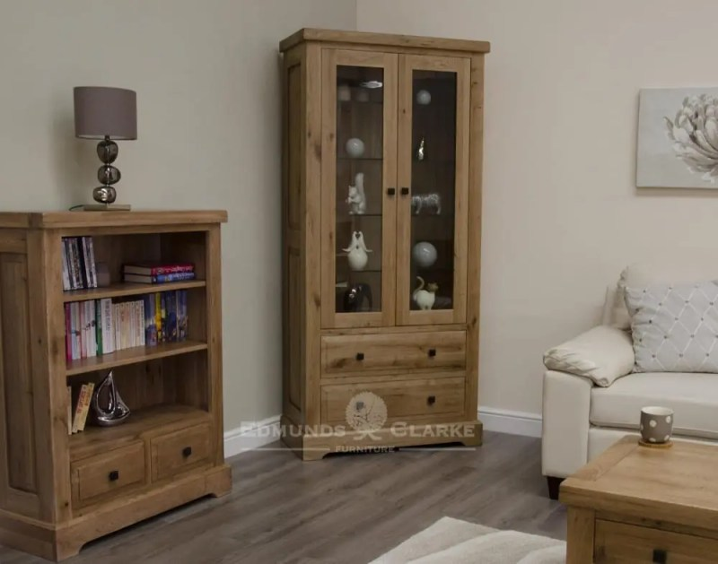 Melford deluxe solid oak glass display cabinet deluxe chunky rustic solid oak glass display unit with two drawers and two glass doors with four toughened glass shelves and choice of knobs DLXGDC