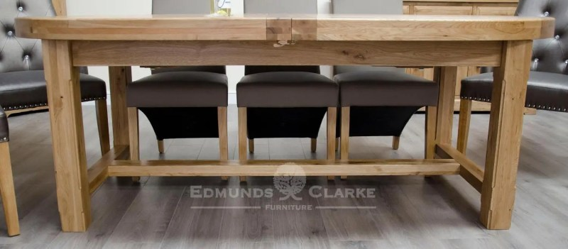 Melford deluxe super oval extending dining table with two stowable leaves